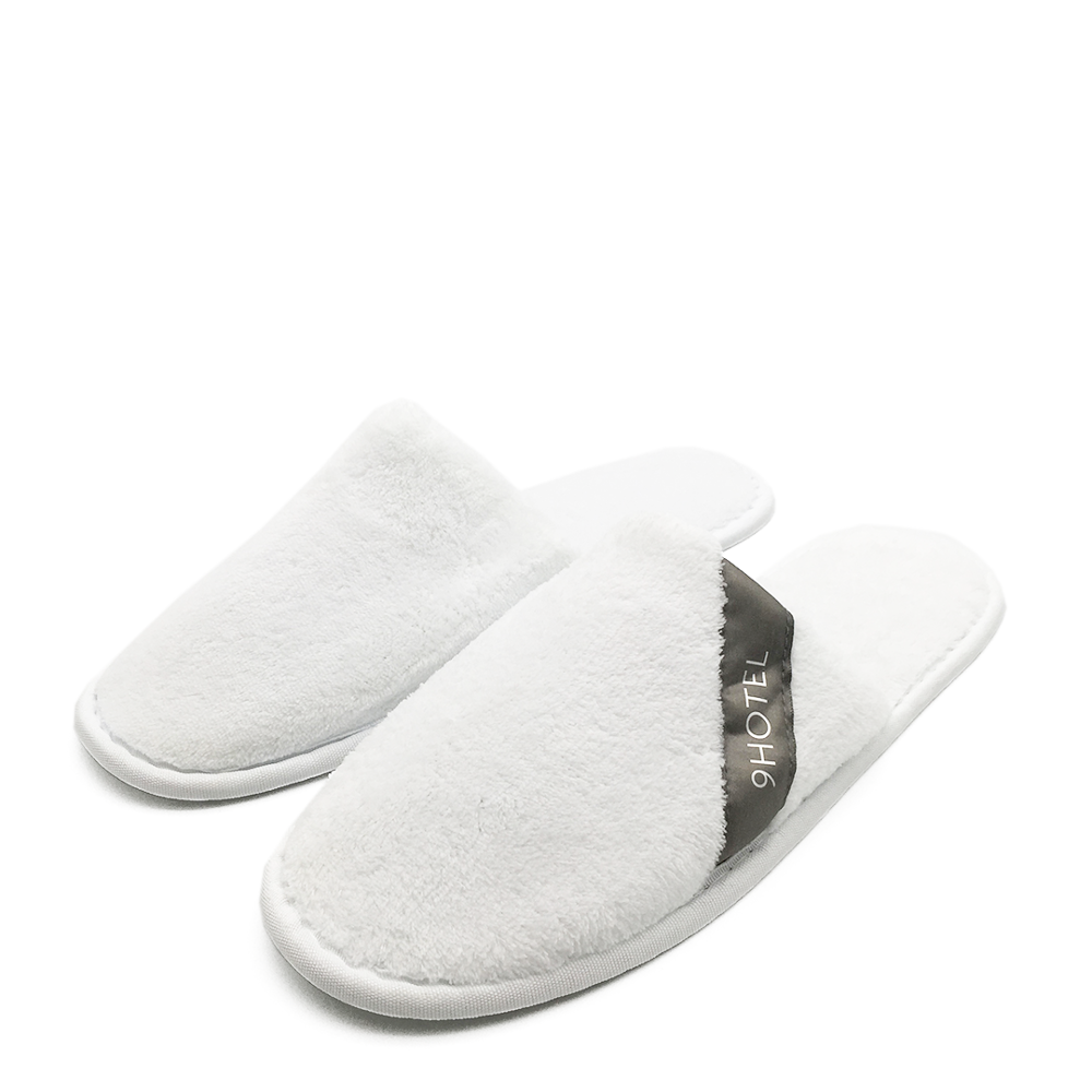 White washable hotel furry slippers
